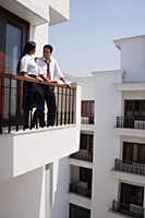 young couple on balcony - Alex Mares-Manton