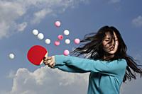 lady hitting ping pong balls - Yukmin