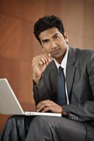 businessman with laptop computer - Alex Mares-Manton