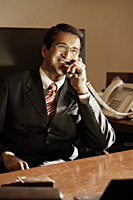 businessman on phone, in office - Alex Mares-Manton