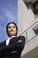 businesswoman standing in front of building - Alex Mares-Manton