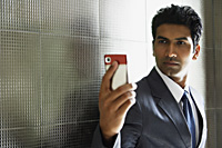 businessman using mobile phone - Alex Mares-Manton