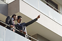 businessmen standing on balcony - Alex Mares-Manton