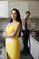 young couple posing for camera in kitchen - Alex Mares-Manton