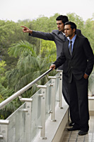 businessmen standing at balcony - Alex Mares-Manton