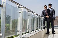 businessmen standing on balcony - Alex Mares-Manton