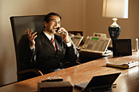 businessman in office, on phone - Alex Mares-Manton
