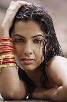 young woman wearing many bangles - Alex Mares-Manton