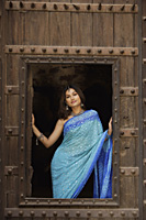 young woman in sari, posing from window - Alex Mares-Manton