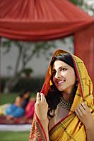 young woman in yellow sari - Alex Mares-Manton