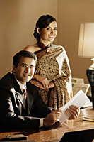 couple in office, woman in sari - Alex Mares-Manton