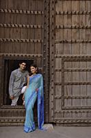 young couple posing at wooden doorway - Alex Mares-Manton