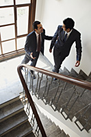 businessmen walking up the stairs - Alex Mares-Manton