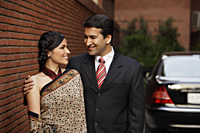couple in front of car, woman in sari - Alex Mares-Manton