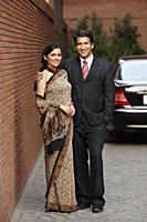 couple in front of car, woman in sari - Alex Mares-Manton