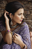young woman in sari, hand on hair - Alex Mares-Manton