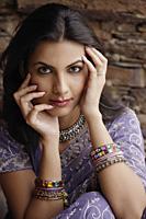 young woman in sari, hands on face - Alex Mares-Manton