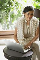 woman in sari at laptop - Alex Mares-Manton