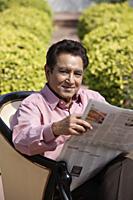 man reading newspaper - Alex Mares-Manton