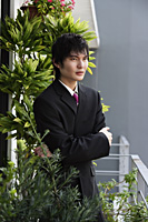 young man in suit, crossed arms - Yukmin