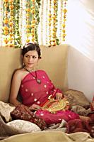 young woman relaxing, wearing sari and bindi - Alex Mares-Manton