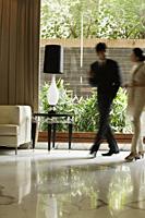 colleagues in hotel lobby - Alex Mares-Manton