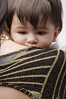 woman holding baby - Alex Mares-Manton