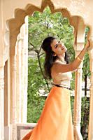 young woman in sari at terrace balcony - Alex Mares-Manton