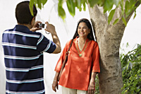 man taking photograph of woman - Alex Mares-Manton