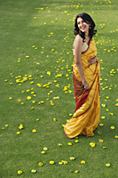 young woman in yellow sari - Alex Mares-Manton