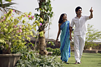 young couple strolling in garden - Alex Mares-Manton