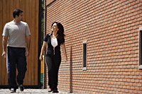 couple walking, in exercise clothing - Alex Mares-Manton