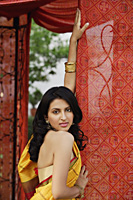 woman in yellow sari, red tent - Alex Mares-Manton
