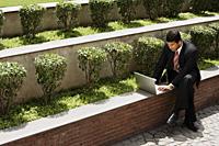 businessman working outside, laptop computer - Alex Mares-Manton
