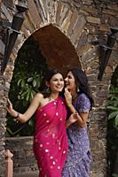 young women in saris, gossiping - Alex Mares-Manton