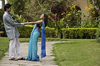young couple dancing in garden - Alex Mares-Manton