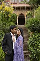 young couple embracing, woman in sari - Alex Mares-Manton