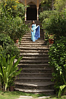 young woman in sari, standing on stairs - Alex Mares-Manton