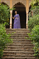 young woman in sari, standing at top of stairs - Alex Mares-Manton