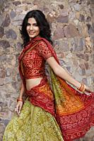 young woman in sari, stone wall - Alex Mares-Manton