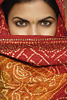 woman in sari, covering face - Alex Mares-Manton