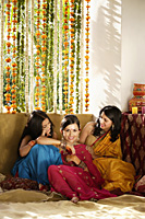 three young women wearing saris - Alex Mares-Manton