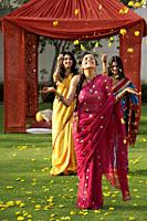 three young women wearing saris - Alex Mares-Manton