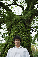 young man standing in front of tree - Yukmin