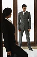 Businesswoman looking at businessman - Alex Mares-Manton