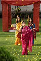 three women wearing saris in front of tent - Alex Mares-Manton
