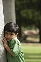 Little boy hugging tree trunk - Vivek Sharma