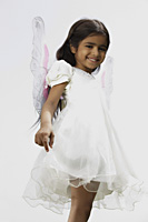 little girl dressed in white dress and wings - Vivek Sharma