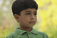 serious little boy wearing green shirt - Vivek Sharma