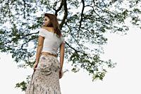 Woman standing under tree - Yukmin